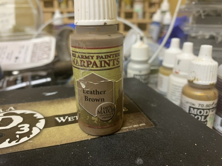 Once the glue dried I used Army Painter Leather Brown on the base.