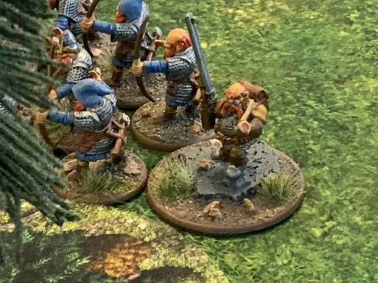 The Lieutenant at the other side of the archers. Both units are hidden behind a forest.