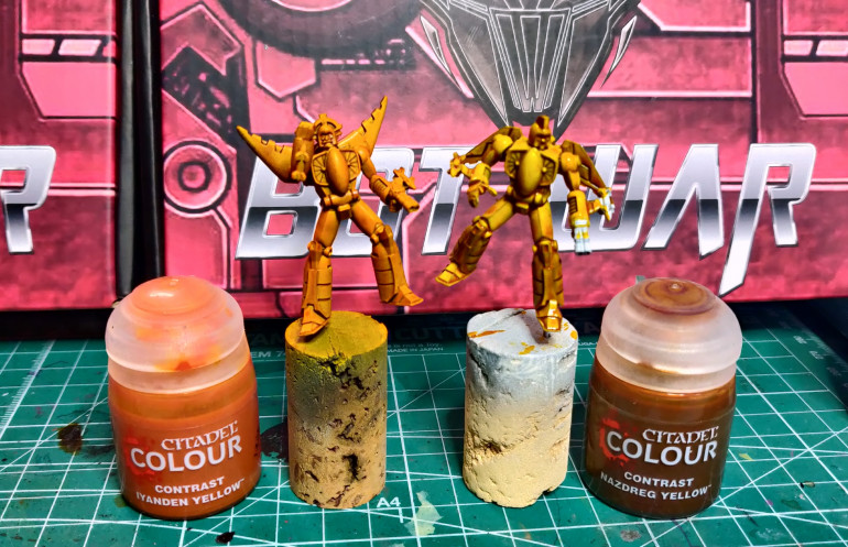 Moray, with Iyanden Yellow from an airbrush on the left, Stingray with Nazdreg yellow using a brush on the right