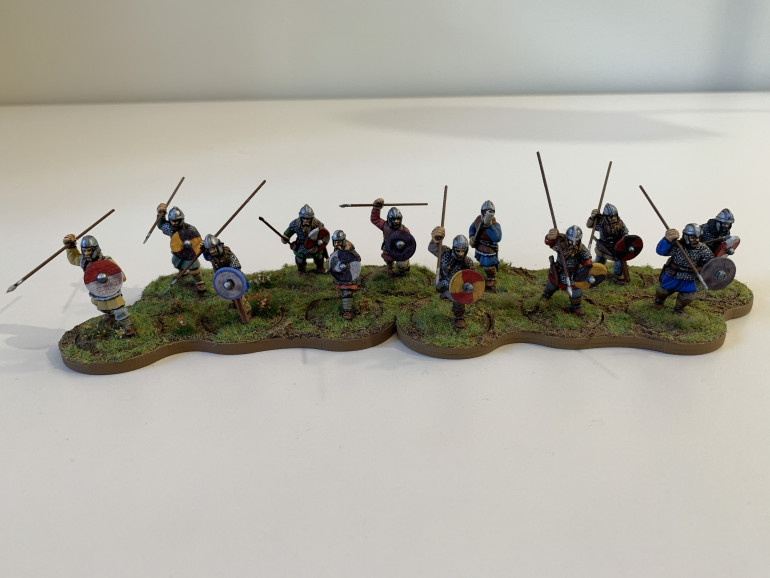 Saxon warriors. In two of them I managed to get paint either on or behind the shield transfer, but I think it passes nicely as battlefield muck!