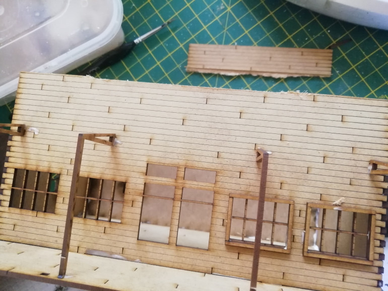 Chopped away some of the signage to resemble the video game and swapped the roof out for some corrugated card.