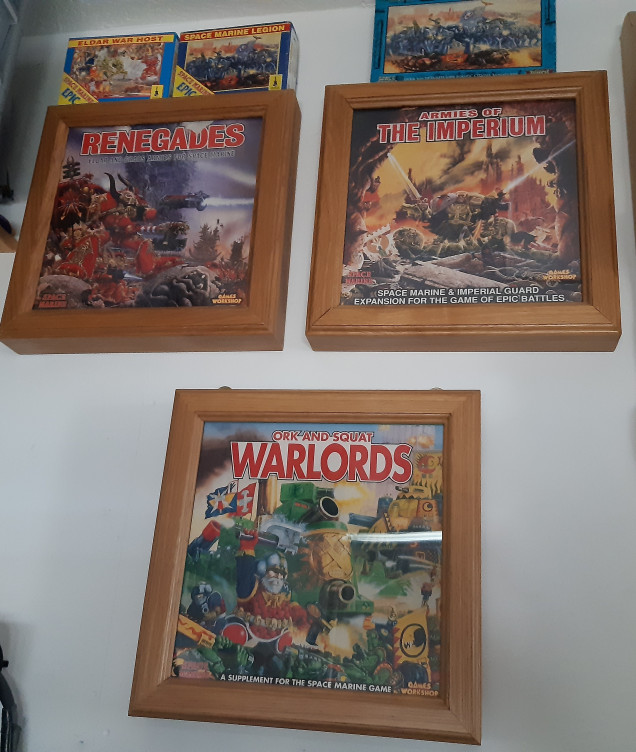 Wall art just missing the hive wars. Home made frames for boxes.