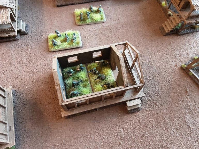 The big houses can hold 2 medium FoW bases and the small houses one medium base. The tower 1 small base.