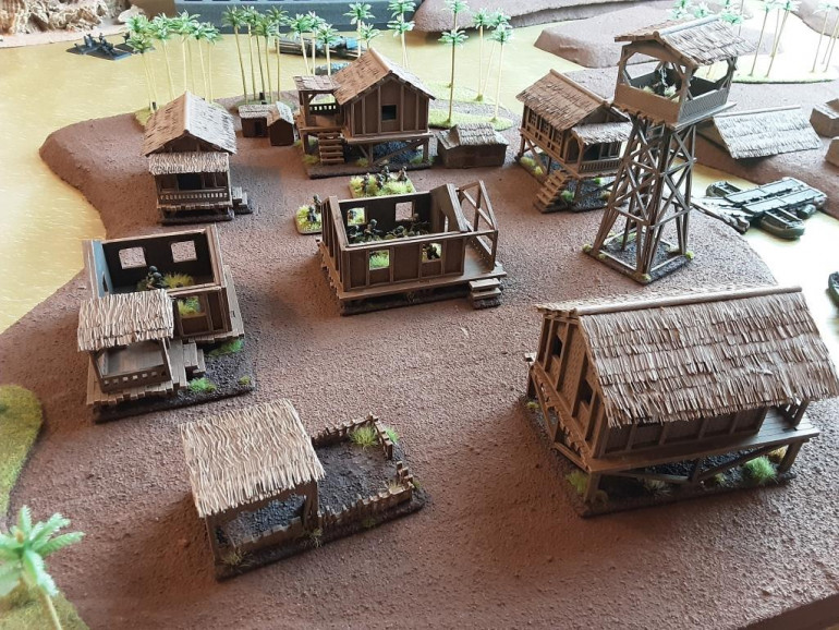 The sharp eye will notice some other 15mm huts from flashpoint miniatures between. The scale creep is quite noticable.