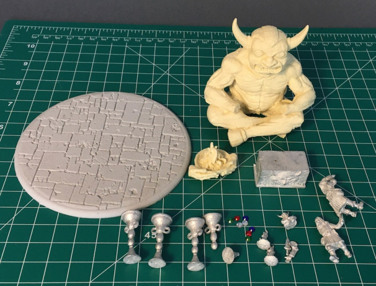 There is actually double the number of metal pieces as the braziers in his original set had arrived broken and the company just sent him another set.