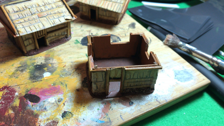 Painting the huts