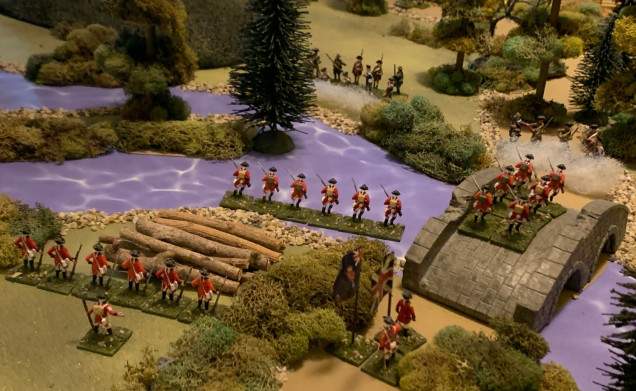 The British left, where Light Infantry companies of three regiments (about 120 men effective strength) are pushing across the creek, while line companies push over the bridge and try to provide fire support from the friendly bank.