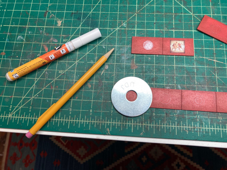 using a washer as a template I drew circles onto the wall sections. I filled in the circles using a  white ink pen.