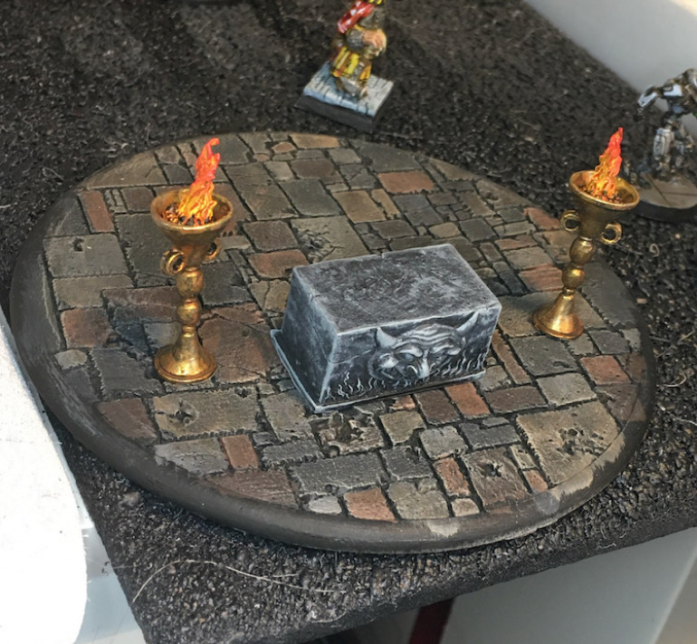 A tiny version of the statue and a sacrificial dagger adorn the learning alter.