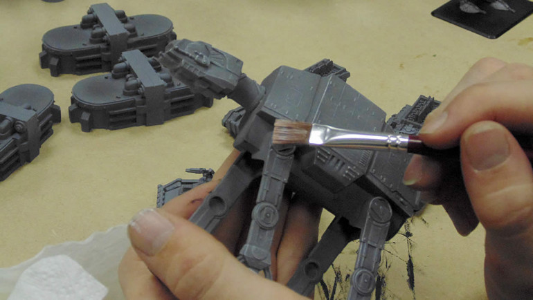 Dry brushing the At-Ats for battle
